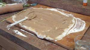 It is a paste of cinnamon, butter, and brown sugar ready to be rolled up in to the spiral of the rolls.