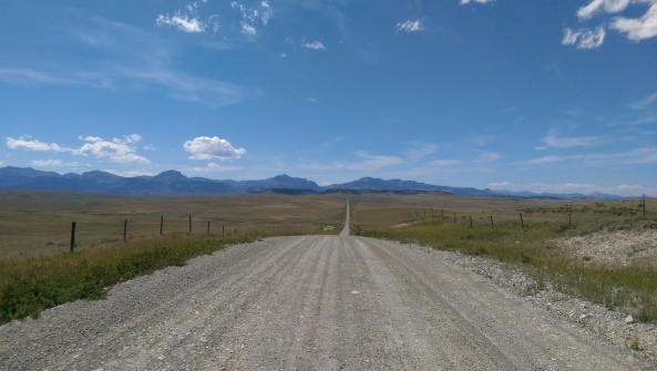 It is the Rocky Mountains rising out of the prairies of of Teton County you can see in the distance.